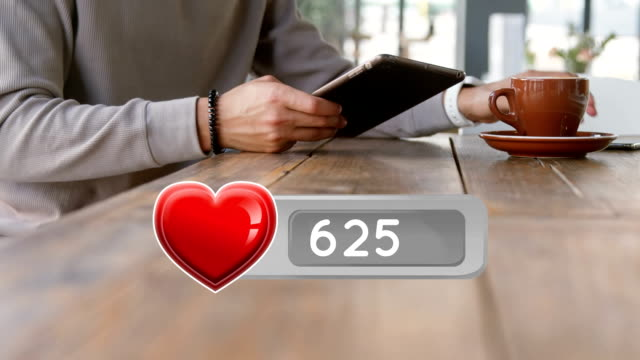 Heart icon and a man using digital devices