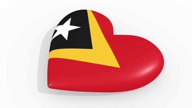 stockvideo's en b-roll-footage met heart in kleuren en symbolen van oost-timor op witte achtergrond, lus - ridderlijkheid