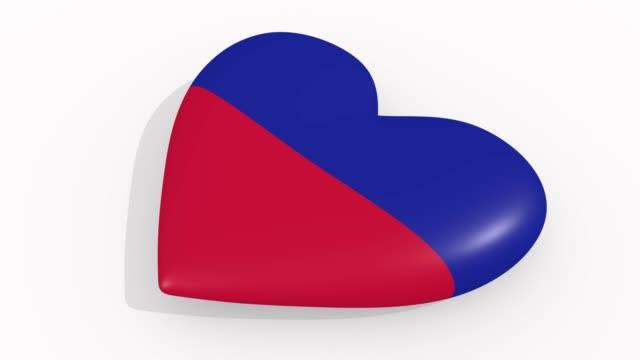 stockvideo's en b-roll-footage met heart in kleuren en symbolen van haïti op witte achtergrond, lus - ridderlijkheid