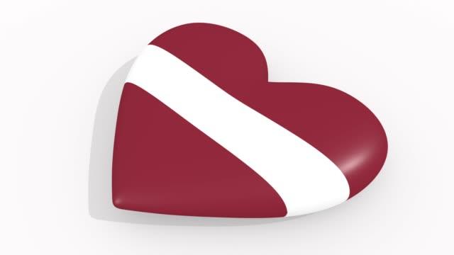 stockvideo's en b-roll-footage met heart in kleuren en symbolen van letland op witte achtergrond, lus - ridderlijkheid