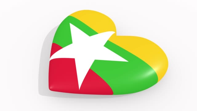 heart in colors and symbols of myanmar on white background, loop - naypyidaw video stock e b–roll