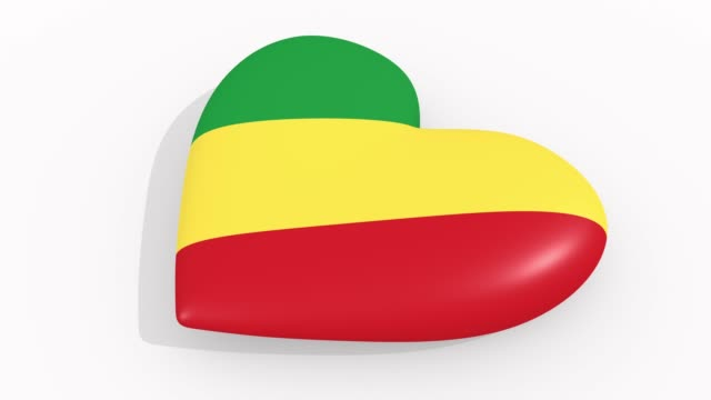 Heart in colors and symbols of Republic of the Congo on white background, loop video