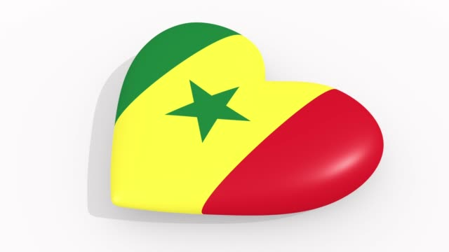 heart in colors and symbols of senegal on white background, loop - dakar video stock e b–roll