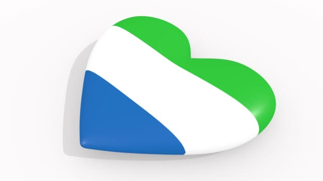 heart in colors and symbols of sierra leone on white background, loop - sierra leone video stock e b–roll