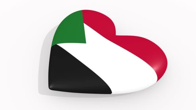 stockvideo's en b-roll-footage met heart in kleuren en symbolen van soedan op witte achtergrond, lus - ridderlijkheid