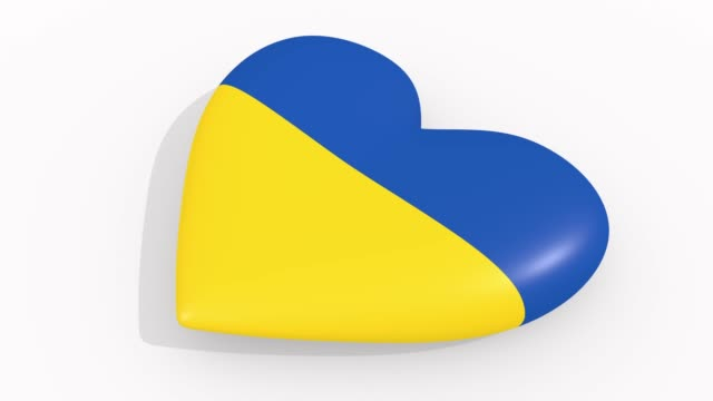stockvideo's en b-roll-footage met heart in kleuren en symbolen van oekraïne op een witte achtergrond, lus - ridderlijkheid