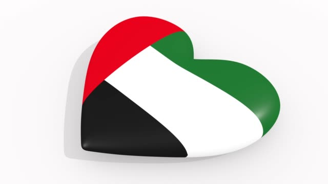 heart in colors and symbols of united arab emirates on white background, loop - uae national day стоковые видео и кадры b-roll