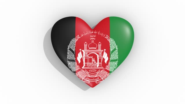 heart in colors flag of afghanistan pulses, loop - simbolo concettuale video stock e b–roll