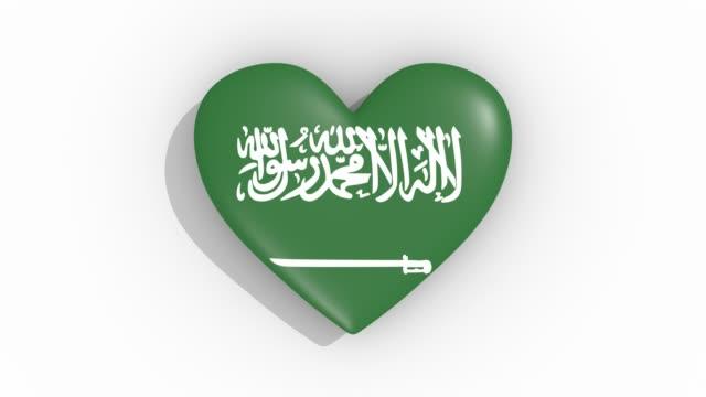 사우디 아라비아 펄스의 색 기에 심 혼, 루프 - saudi national day 스톡 비디오 및 b-롤 화면