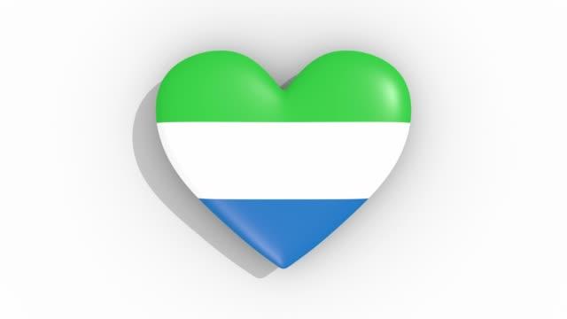 heart in colors flag of sierra leone pulses, loop - sierra leone video stock e b–roll