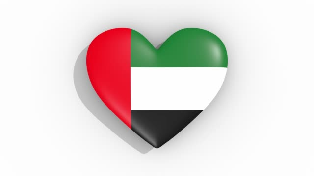 heart in colors flag of united arab emirates pulses, loop. - uae national day стоковые видео и кадры b-roll