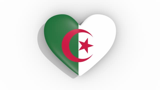 heart in colors of flag of algeria pulses, loop - simbolo concettuale video stock e b–roll