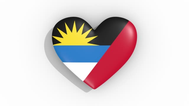 heart in colors of flag of antigua and barbuda pulses, loop. - simbolo concettuale video stock e b–roll