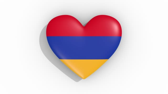 heart in colors of flag of armenia pulses, loop - simbolo concettuale video stock e b–roll