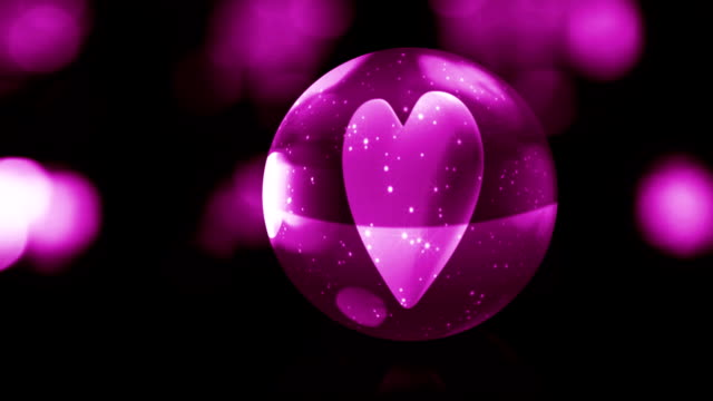 heart in pink glass ball with snow video