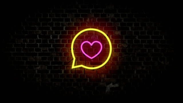 heart like and love in speech bubbles. neon sign glowing on brick wall background. motion 4k footage. happy valentine's day