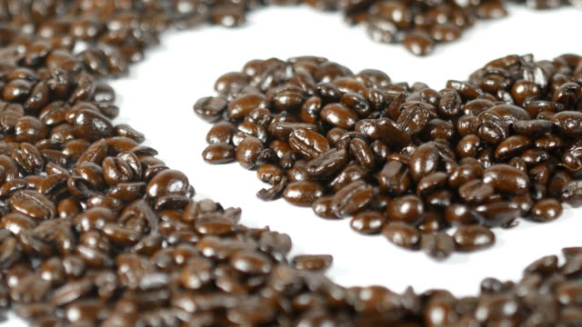 Heart of coffee beans on the table video