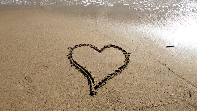 heart shape at the beach - surf garage bildbanksvideor och videomaterial från bakom kulisserna