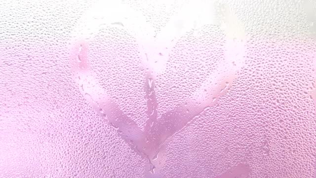 Heart shape close up on the window. video