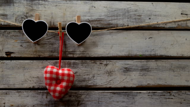 heart shaped decoration pinned on a rope 4k - simbolo concettuale video stock e b–roll