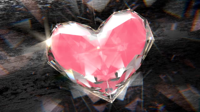 Heart shaped diamond rotating and shining, with caustic light, seamlessly loopable
