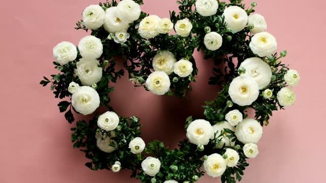 Heart shaped flowers bouquet. Ranunculus bouquet. Heart shaped buttercups.  white flowers ranunulus Wedding day. Valentine's day, birthday