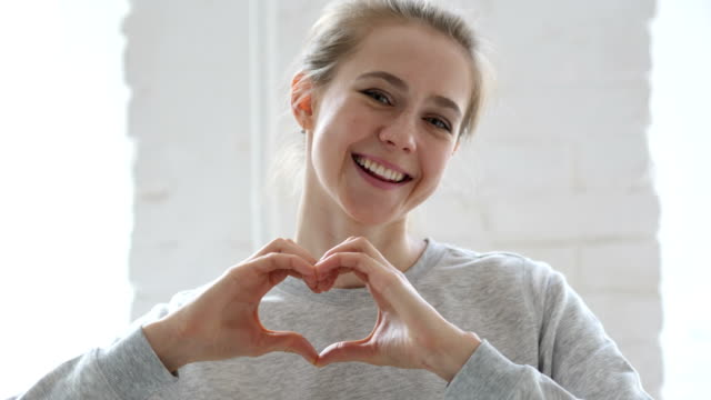 Heart Sign by Young Woman in Love, Hands Gesture Heart Sign by Young Woman in Love, Hands Gesture gesturing stock videos & royalty-free footage