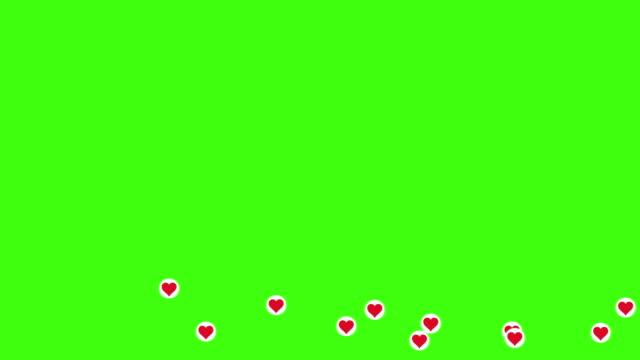 heart symbol come flying accross the green screen - emoji video stock e b–roll