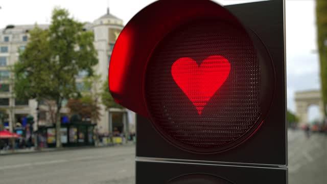 Heart symbol on red traffic light signal