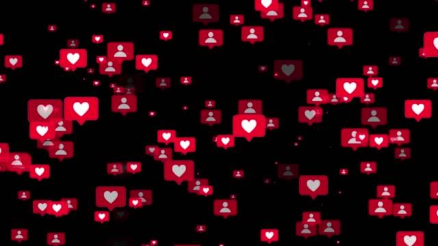 cuori e utenti icone dei social media galleggianti. animazione di particelle 4k di icone mi piace su sfondo nero - icona dei social network video stock e b–roll