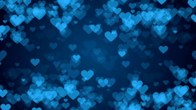 青の背景に心のフレーム。抽象的なバレンタインデー カード。 - バレンタイン点の映像素材/bロール