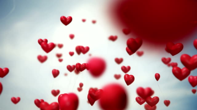 heart-shaped ballons flying (red) - loop - valentines day stock videos and b-roll footage
