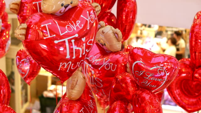 Heart-shaped Valentine balloons in 4K Slow motion 60fps