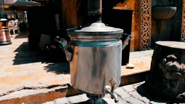 Heated and smoking samovar stands on the streets of Baku, Azerbaijan video