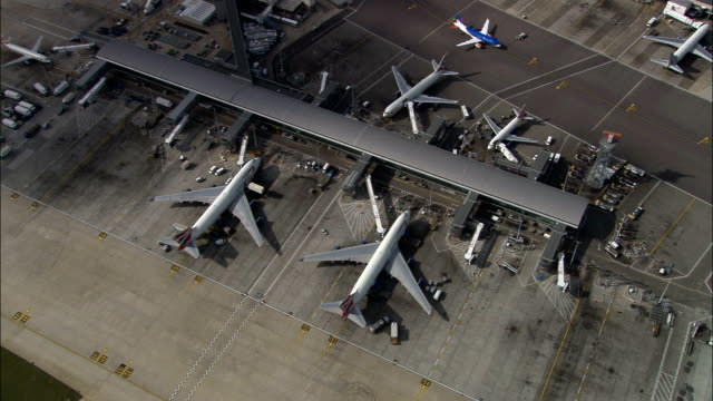 Heathrow  - Aerial View - England, Greater London, Hillingdon, United Kingdom Overhead jets on Stand stationary stock videos & royalty-free footage