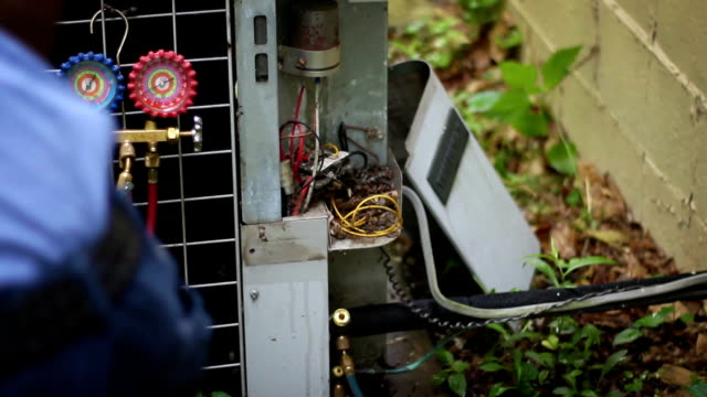 Heating and Cooling Service Technician attempting to salvage old air conditioner video