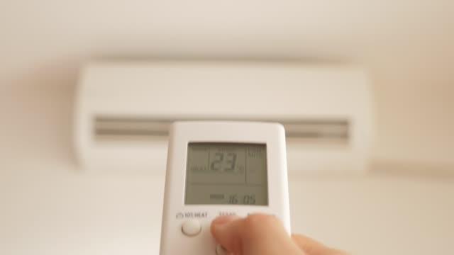 エアコンリモコンの温度を変更することにより、加熱室 4 k - エアコン点の映像素材/bロール