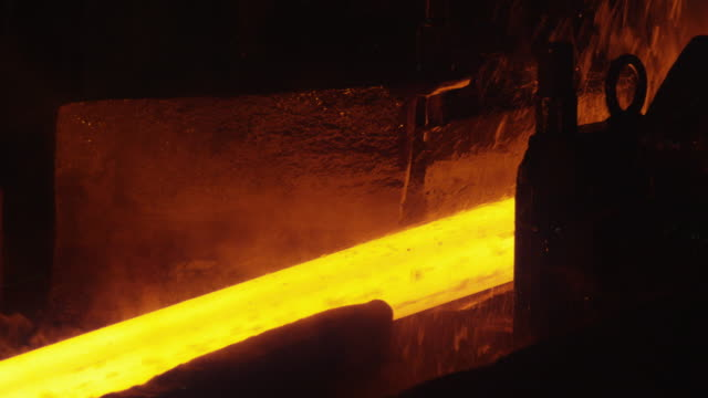 Heavy Industry Machines Processing Melted Burning Hot Metal Bar. Heavy Industry Machines Processing Melted Burning Hot Metal Bar. Shot on RED Cinema Camera in 4K (UHD). furnace stock videos & royalty-free footage