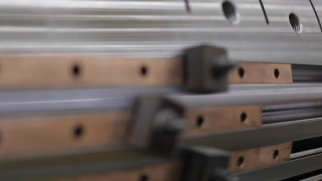 Heavy Industry - Manufacturing - Close Up of a Jig holding Slats on a Large, Machined, Manufactured Object