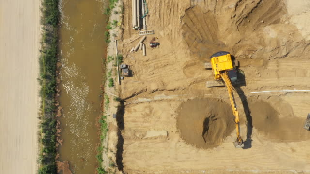 Heavy machinery works of a motorway - Highway Construction. Aerial View
