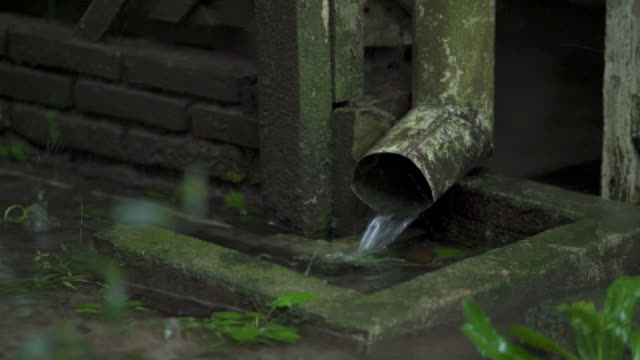 Heavy rain and the old gutters of the house in Rainy Day