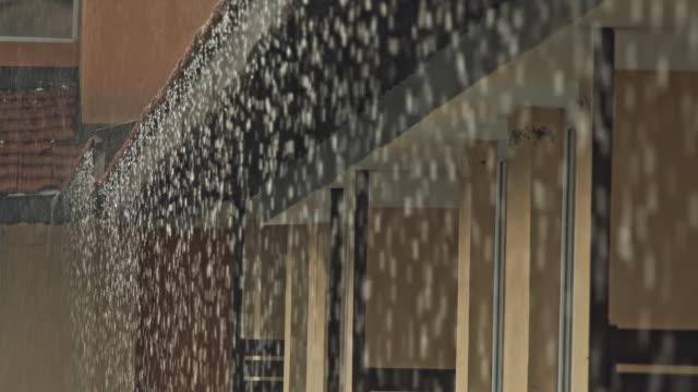 heavy rain on roof - grandine video stock e b–roll