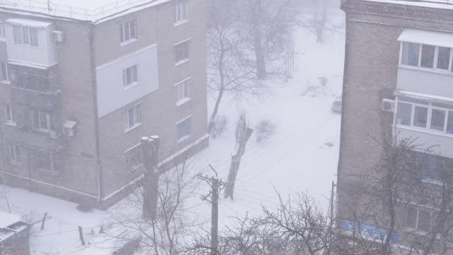 Heavy Winter Snowstorm, Snowfall at Street Corner of Old Multi-Storey Building