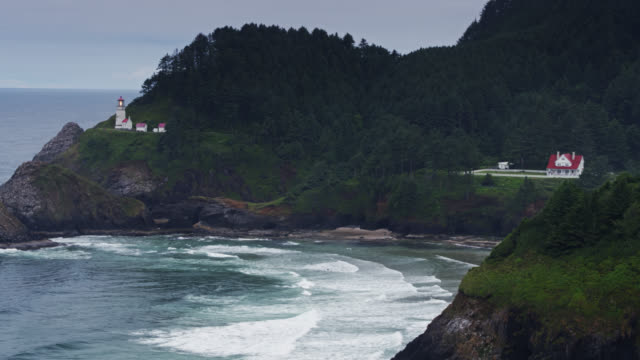 Heceta Head Lighthouse and Beach on Oregon Coast - Drone Shot Drone shot of Heceta Head Lighthouse on the Oregon Coast. extreme terrain stock videos & royalty-free footage