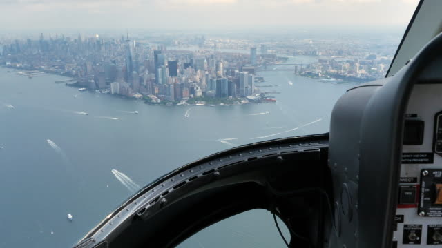 Helicopter Cockpit Views Flying Over Manhattan island in New York city - video
