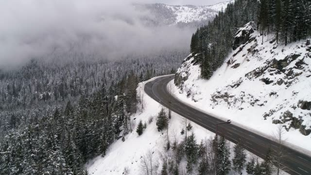 Helicopter Filming Travel on Snow Covered Mountain Road video