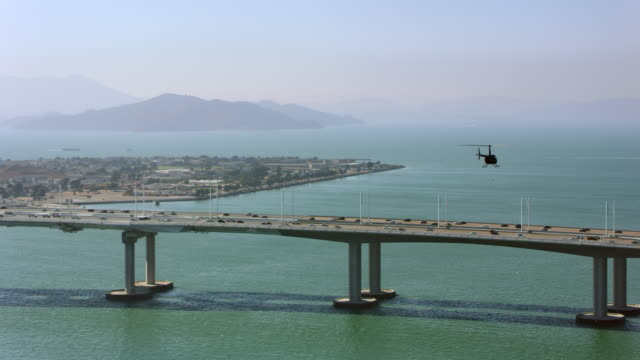 AERIAL Helicopter flying above the Dwight D. Eisenhower Highway on the Bay Bridge in San Francisco