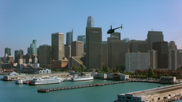 AERIAL Helicopter flying along the piers overlooking the Financial District of San Francisco, CA