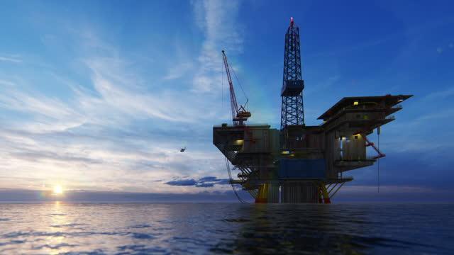 vídeos de stock, filmes e b-roll de helicóptero voando da plataforma de plataforma de petróleo em direção ao belo nascer do sol - baía