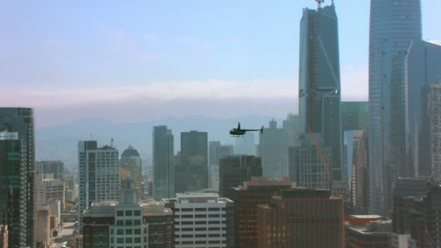 AERIAL Helicopter flying high above the Downtown of San Francisco, CA